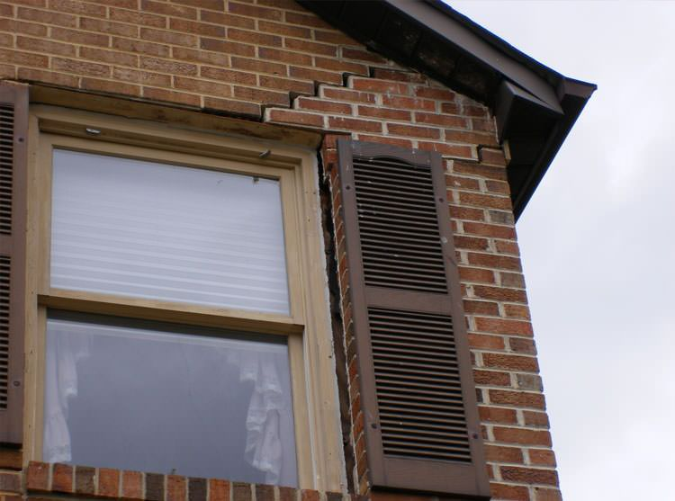 stair step cracking starting at a window in a smithtown home